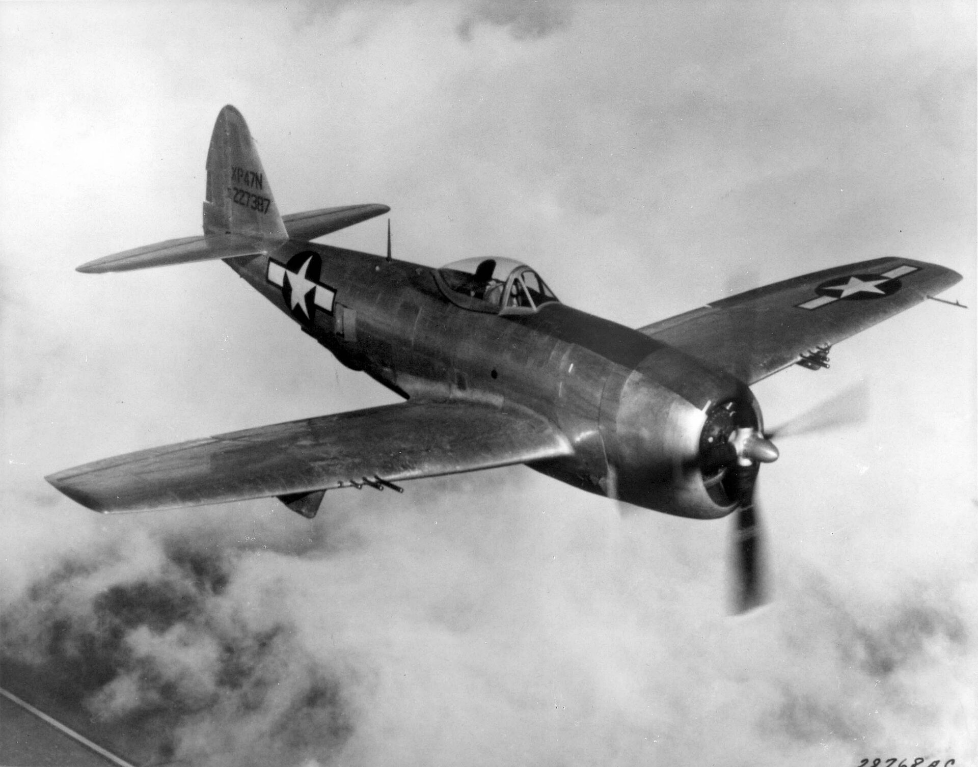 WW2 P-47 fighter plane patrolling the Pacific.
