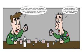 Navy air crewmen not listening while drinking in a bar.