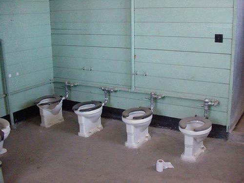 Military barracks toilets are too close together for soldiers.